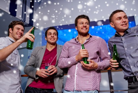group of male friends with beer in nightclub